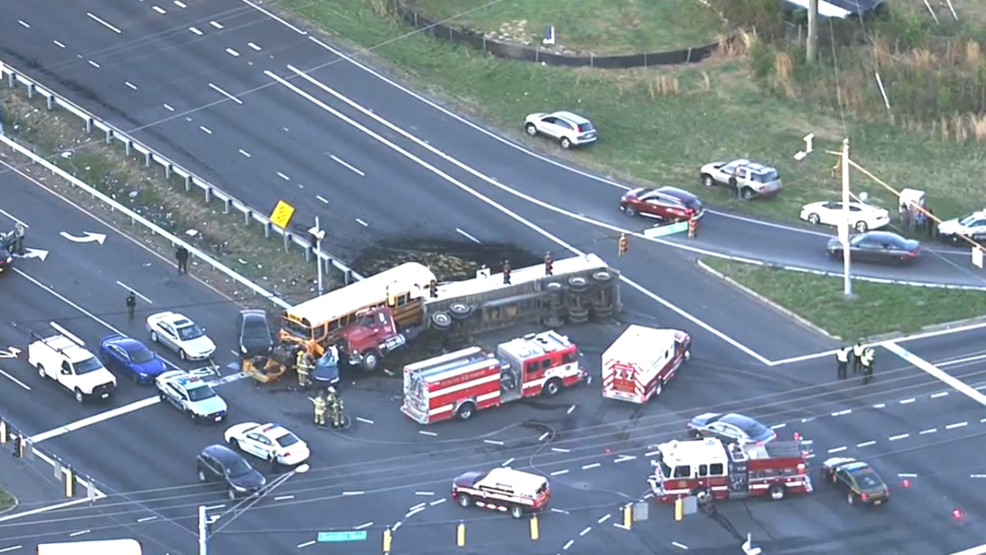 1 killed in crash involving school bus and tractor-trailer